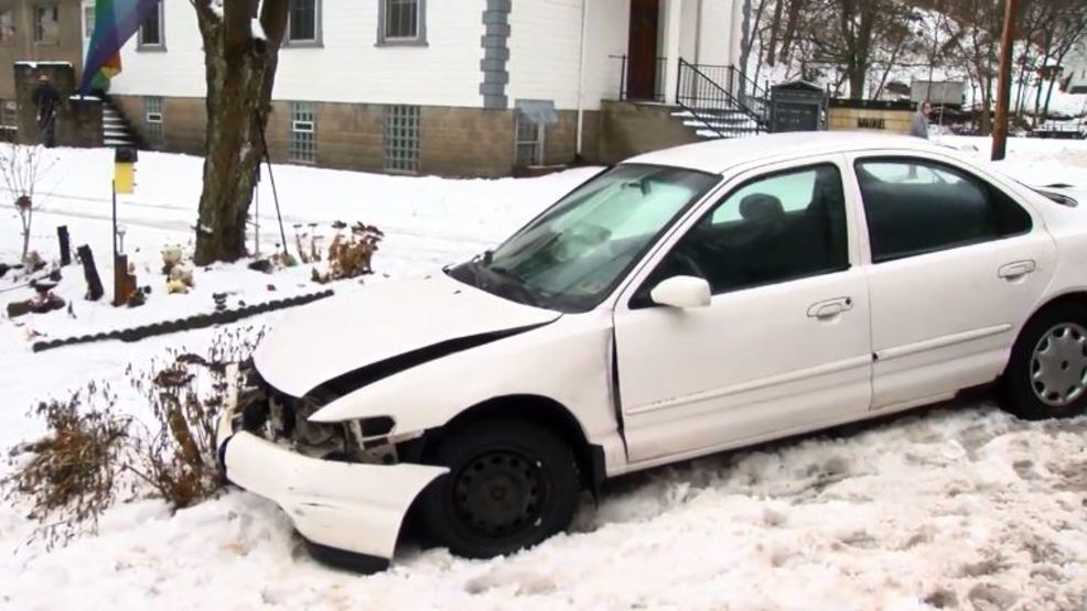 Car slides into front yard following accident on Route 151