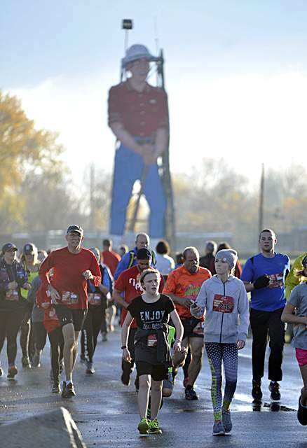 Runners work up their appetites during the Turkey Trot at the Jackson County Expo. [Mail Tribune / Jamie Lusch] - Jamie Lusch