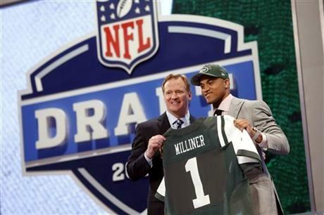 Dee Milliner, from Alabama, stands with NFL Commissioner Roger Goodell after being selected ninth overall by the New York Jets in the first round of the NFL football draft, Thursday night.