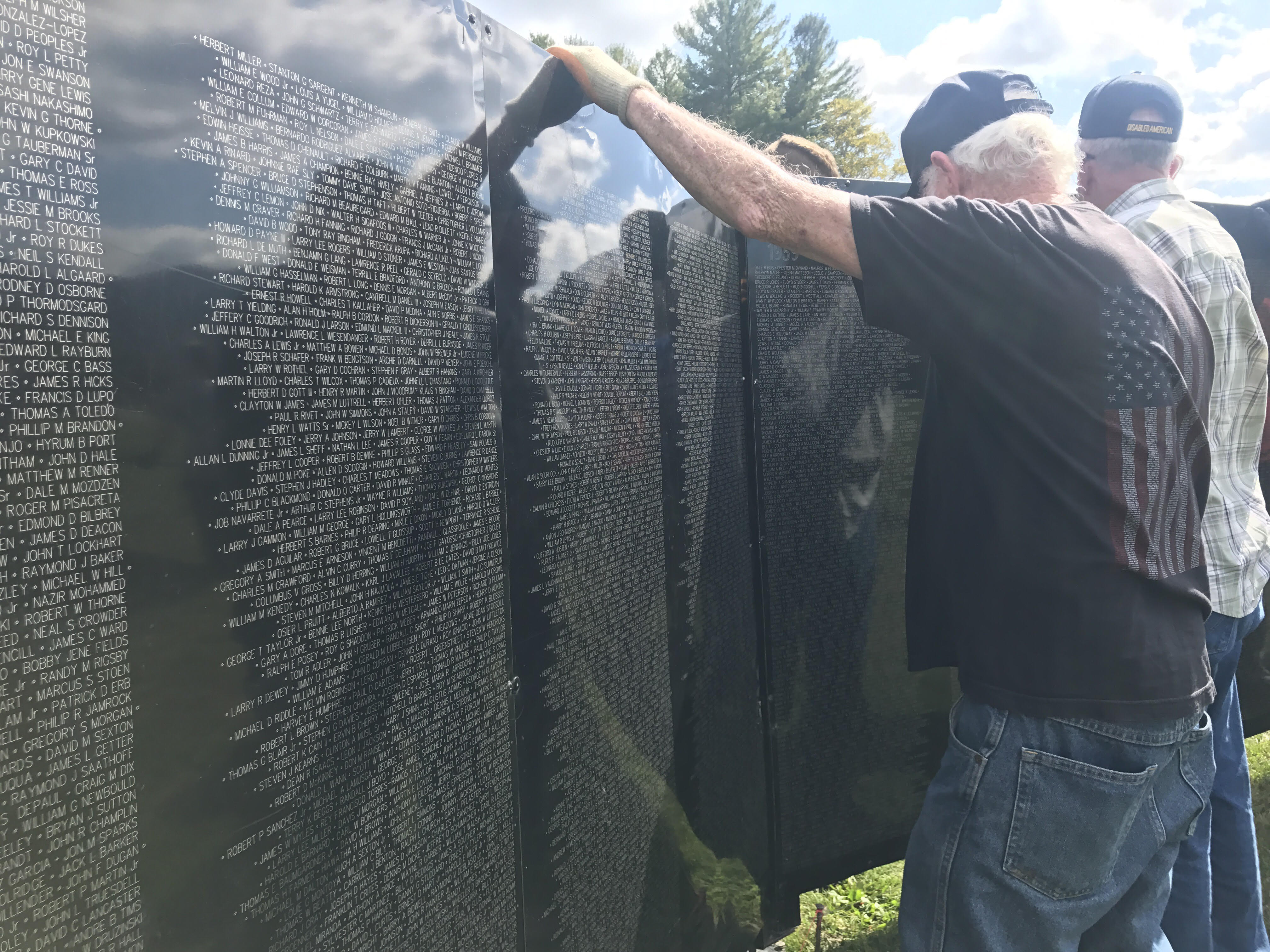 A traveling half-scale replica of the Vietnam Veterans Memorial in Washington. D.C . is on display in Yancey County. A patriotic guard escorted the wall from Marion to Mountain Heritage High School on Wednesday morning. (Photo credit: WLOS staff)