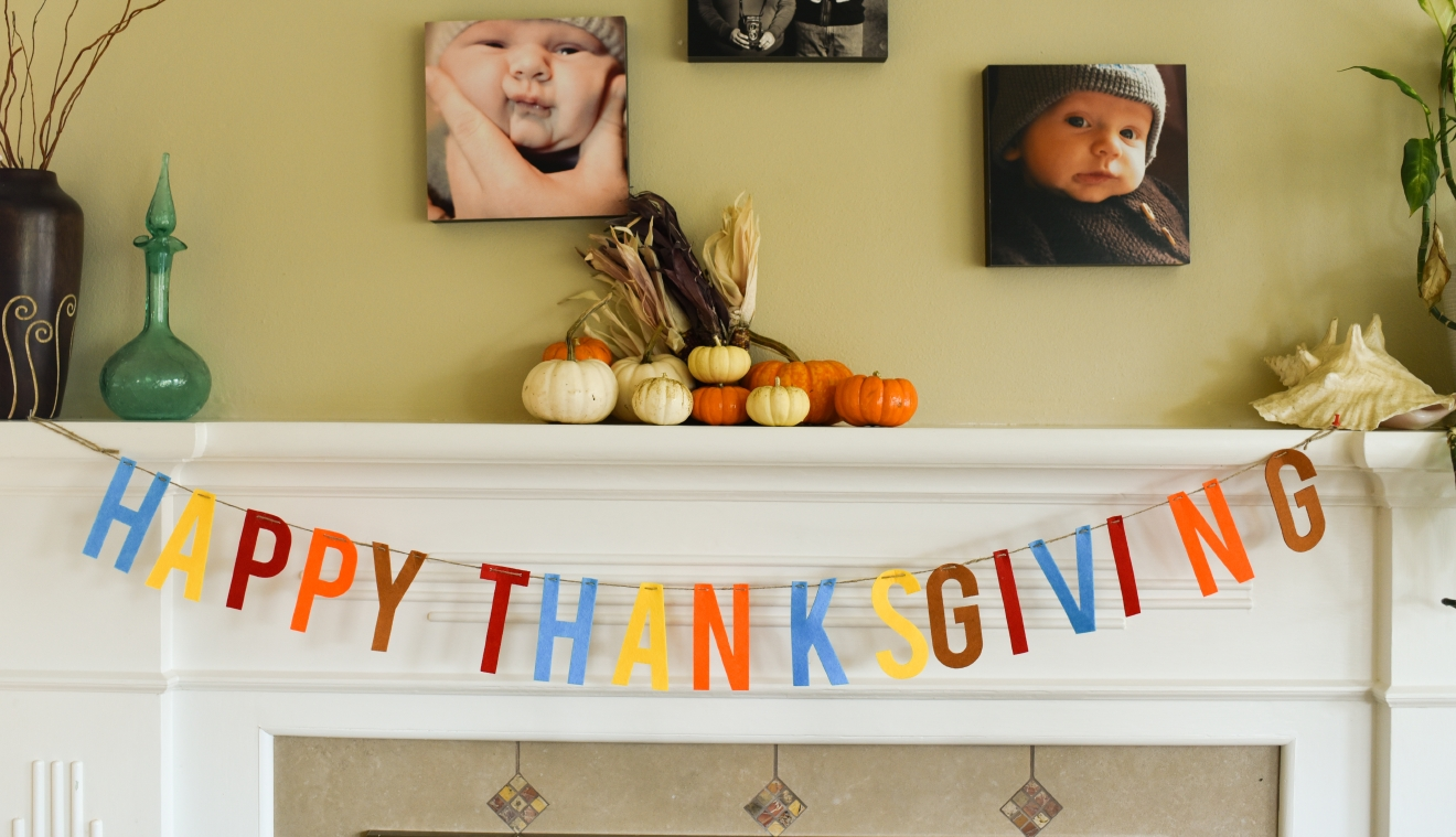 Hang a Thanksgiving banner along with some festive decorations for a fun mantle. (Image: Rebecca Mongrain/Seattle Refined)