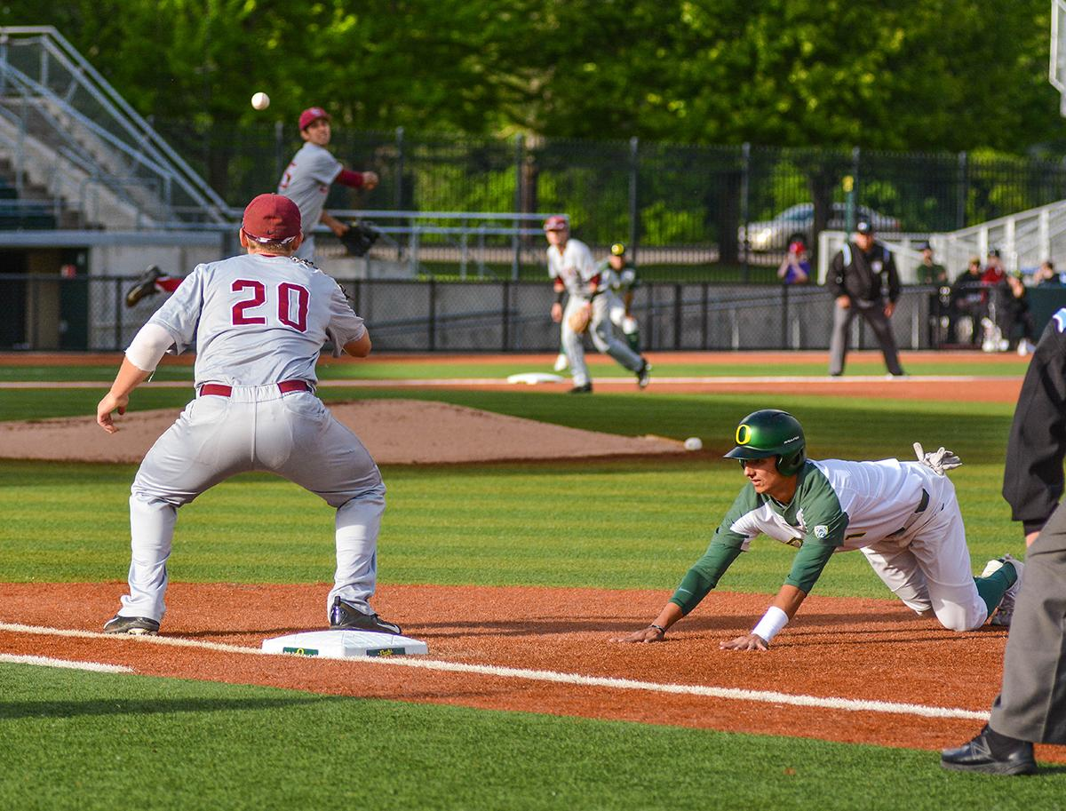 Lions first baseman Jamey Smart (#20) looks to catch the ball in an attempt to get Ducks base runner Kyle Kasser (#1) out. On Wednesday night the Ducks fell to the Loyola Marymount Lions 4-0 at PK Park. Photo by Jacob Smith, Oregon News Lab