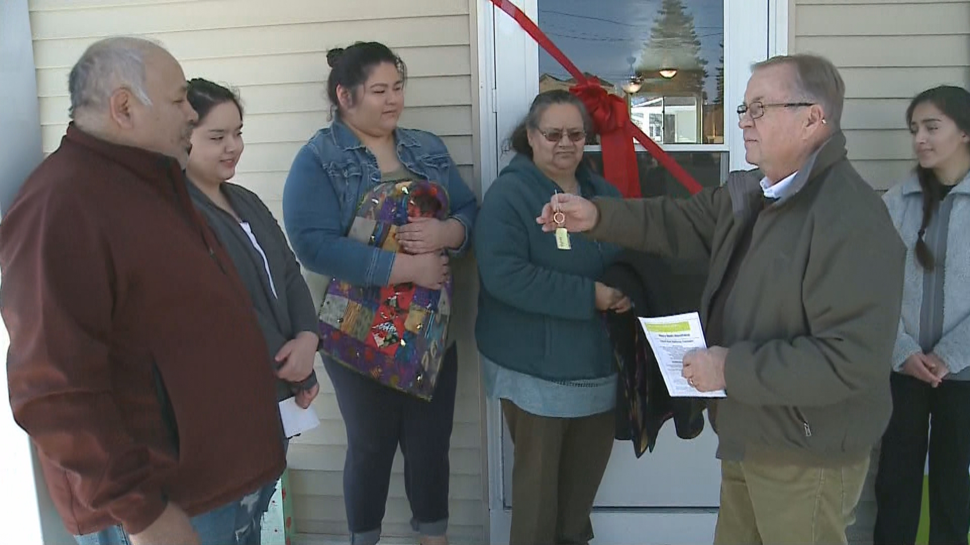 The Martinez Family gets the keys to their new home built by high school students through the Fox Cities Habitat for Humanity in Appleton, January 8, 2018. (WLUK)<p></p>