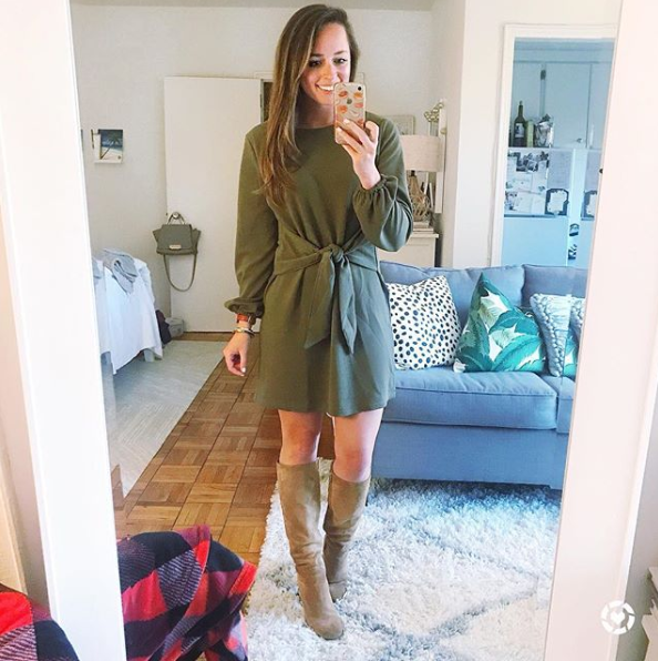 We started seeing variations of this dress a lot over the summer, but we're so glad that it's a transition piece - especially with knee-high boots.{ }(Image via @jennrog)