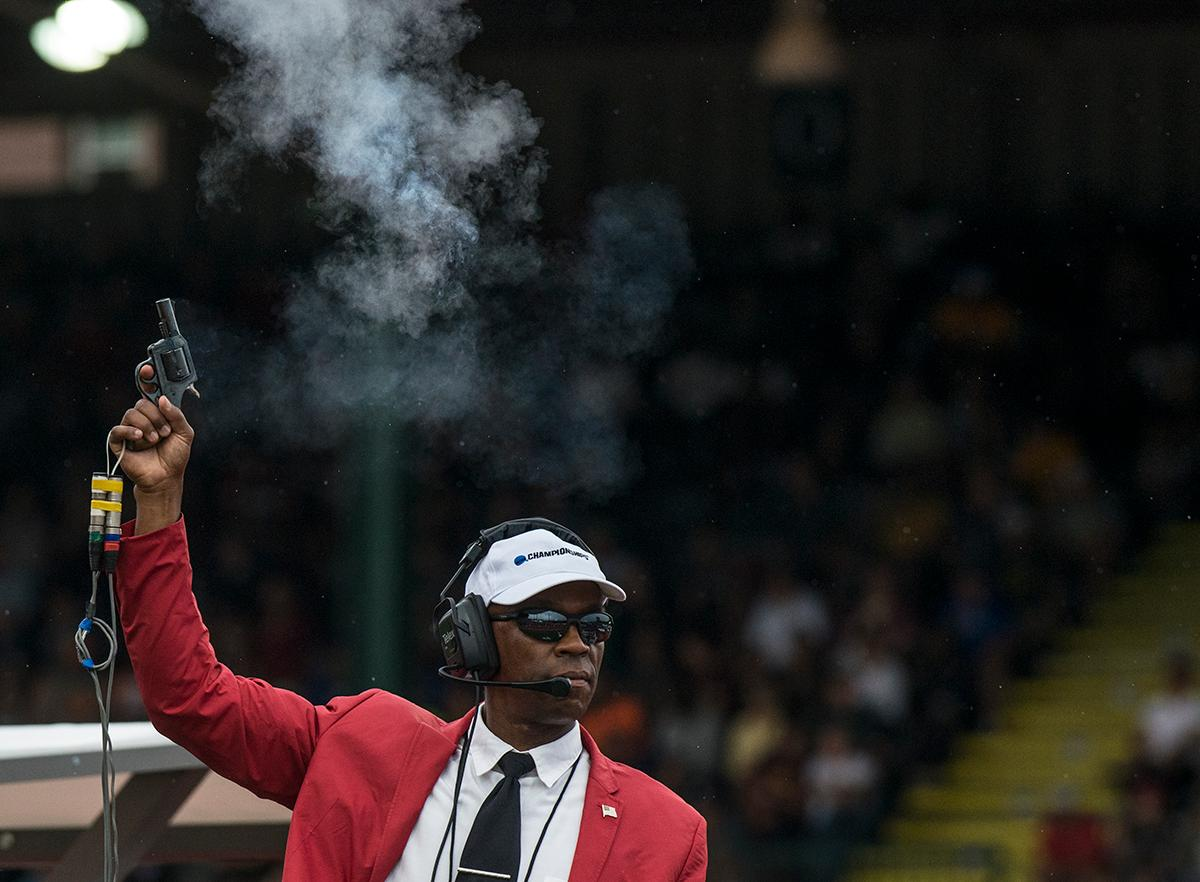 The NCAA Division I Championship official fires the starting gun for the 400m Hurdles on day one of the NCAA Division I Championships at Hayward Field. The event was won by Kemar Mowatt, Arkansas, with a time of 48.64. Photo by Rhianna Gelhart, Oregon News Lab