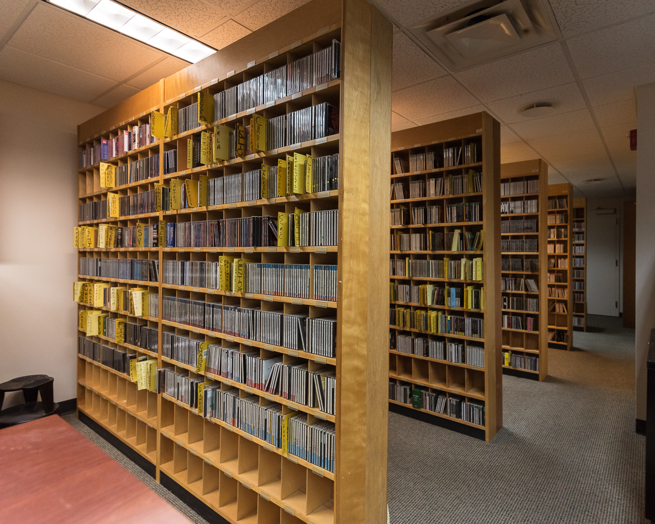 Every bit of music WVXU's neighbor station, WGUC, plays is stored in a physical library. Digital copies of each track are used, but the station is required to maintain the physical copies. There are roughly 8000 total CDs in the library, and WVXU has access to pull music from it when needed. / Image: Phil Armstrong, Cincinnati Refined // Published: 12.12.17