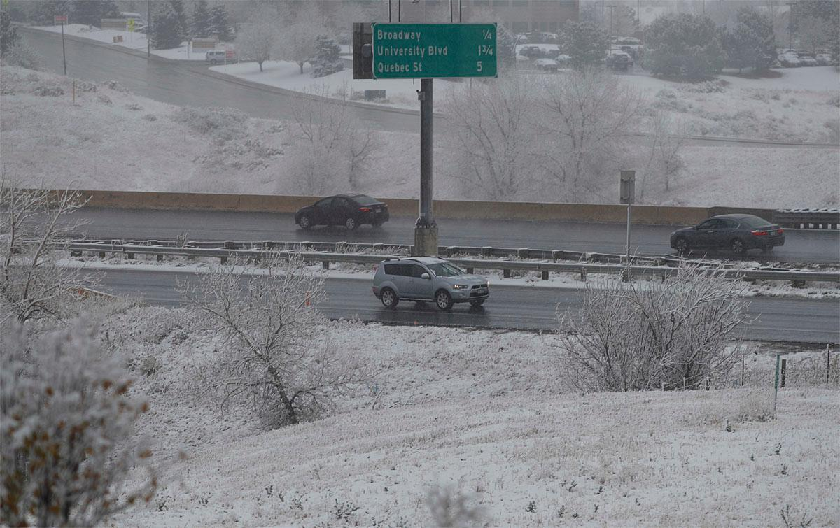 Motorists guide their vehicles down C-470 as a weak, autumnal storm sweeps over the intermountain West, Thursday, Nov. 17, 2016, and leaves a dusting of snow on the grassy areas around the highway in Highlands Ranch, Colo. The fast-moving storm is predicted to drop up to a foot of snow in the upper reaches of Minnesota. (AP Photo/David Zalubowski)
