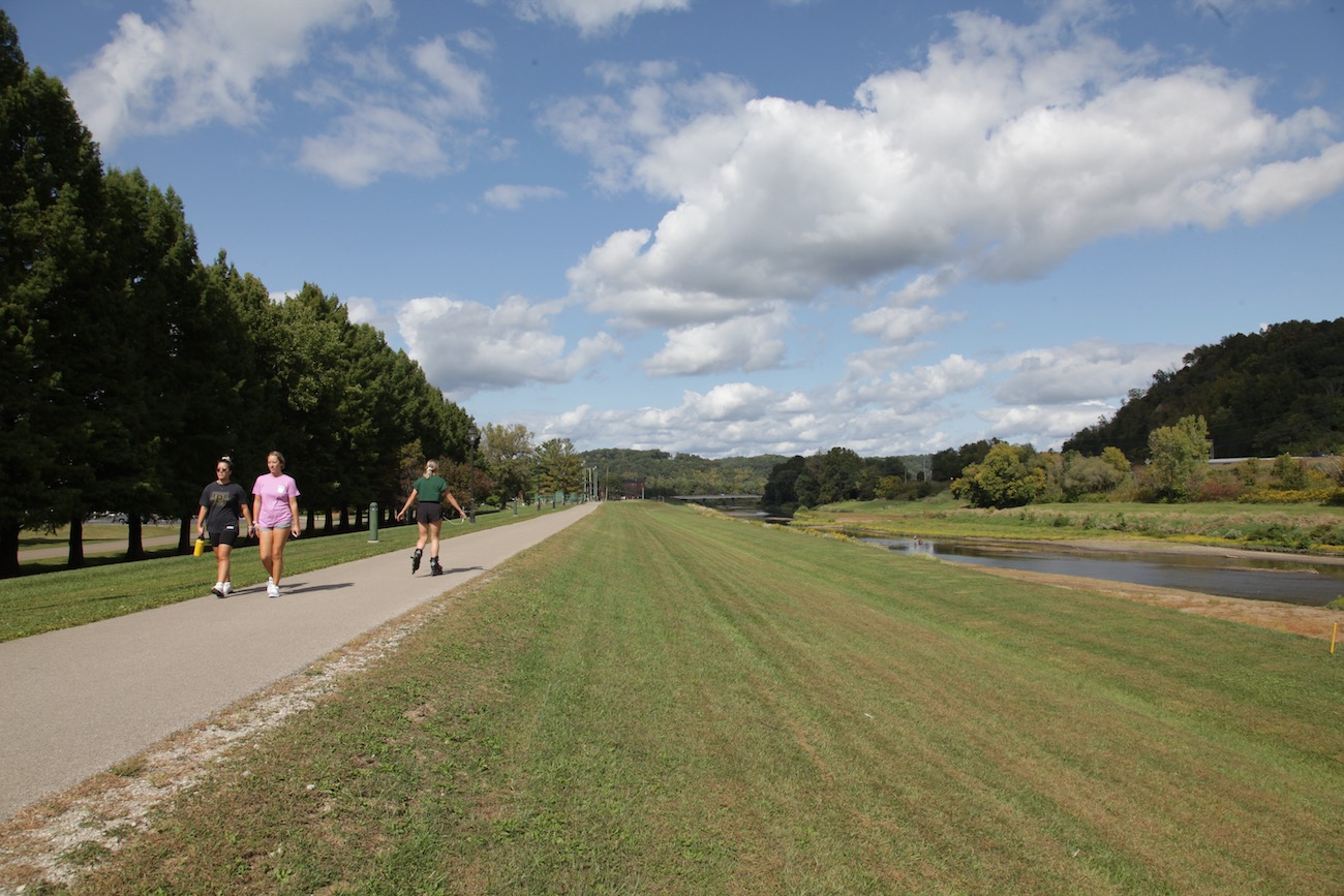 The easily accessible Hockhocking Adena Bikeway stretches 21 miles from Athens to Nelsonville. The bikeway winds along the Hocking River, past the Ohio University campus and through serene woodlands. / Image: Chez Chesak // Published: 10.27.20