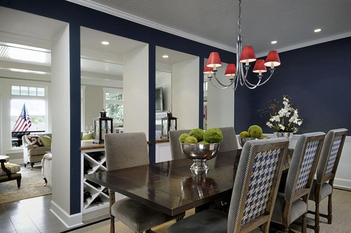 This Kenmore home has a great red, white and blue living room complete with blue and white hounds tooth backed chairs! The project was completed by Graciela Rutkowski Interiors.   (Image: Kenmore Home / Porch.com)