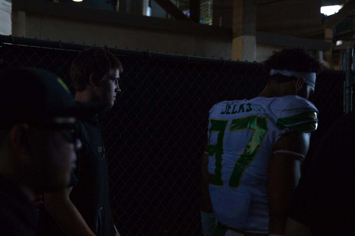 Injured Oregon quarterback Justin Herbert walks into the lockerroom with his team tied at halftime. The Oregon Ducks rallied during the second quarter to go into halftime tied 14-14 with the UCLA Bruins at Rose Bowl Stadium in Pasadena, California. Photo by Austin Hicks, Oregon News Lab