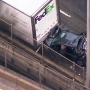 Driver jumps out before car crushed between semi and SUV on Marquam Bridge
