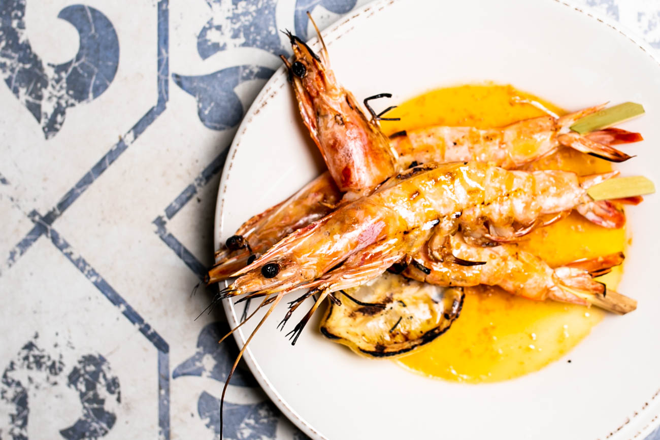 Grilled whole prawns served in anchovy butter / Image: Amy Elisabeth Spasoff // Published: 5.22.18