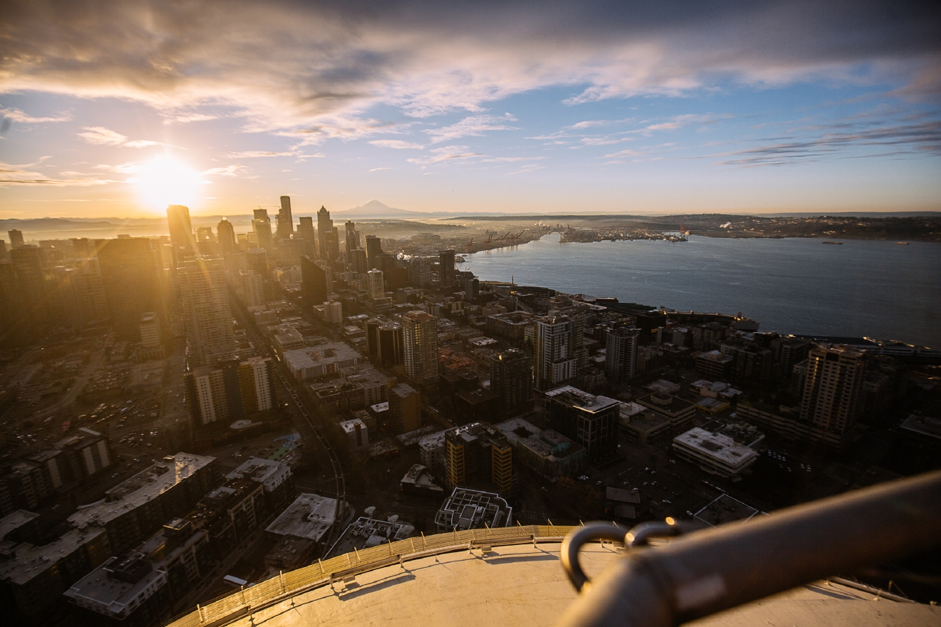 Seahawks legend Dave Krieg had the honor of raising the 12th Flag atop the Space Needle for the big Seahawks playoff game tomorrow against the Detroit Lions. Each year the Space Needle brings a former Seahawks player to raise the flag. (Image: Joshua Lewis / Seattle Refined)