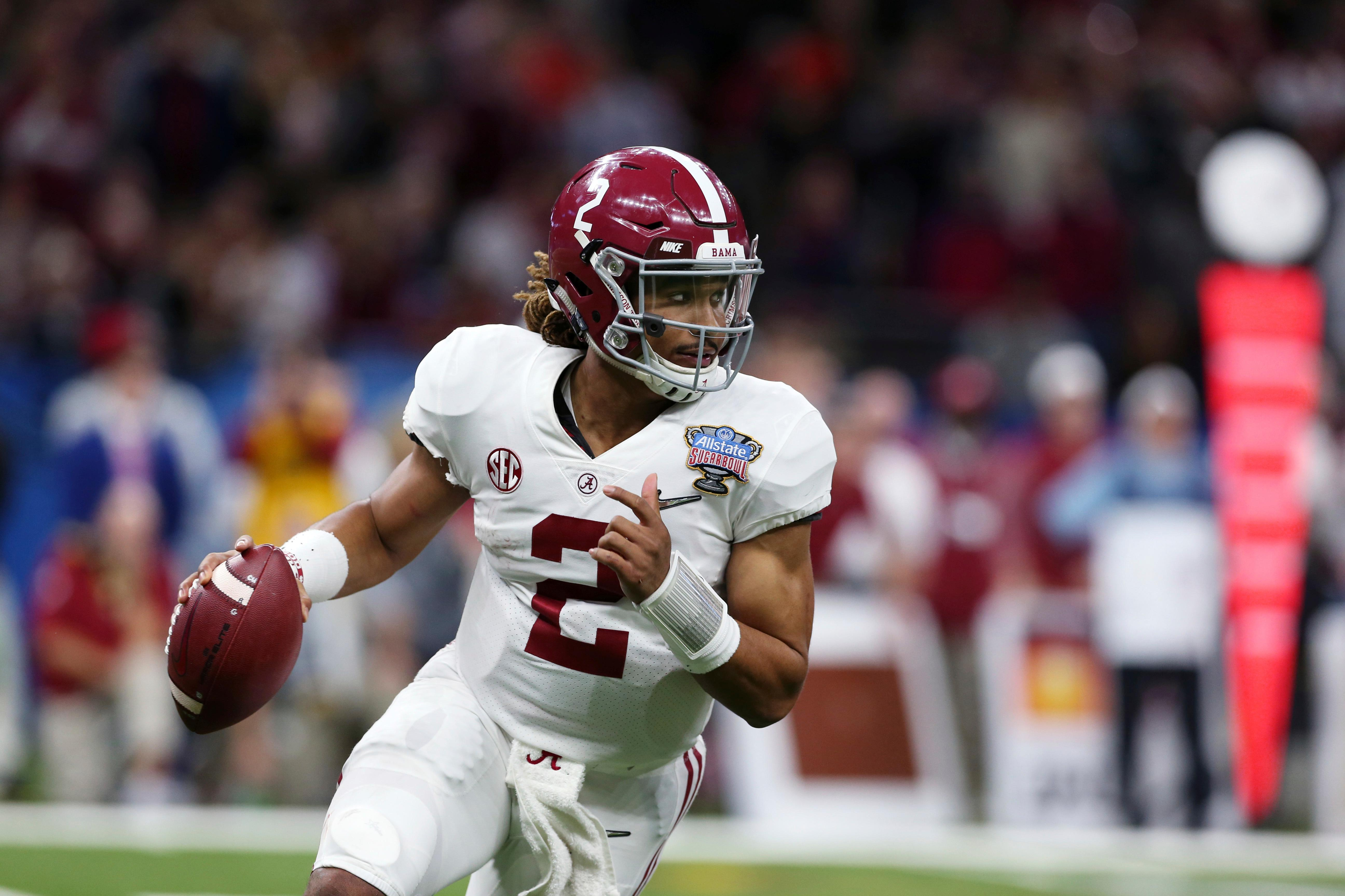Alabama quarterback Jalen Hurts (2) scrambles in the second half of the Sugar Bowl semi-final playoff game against Clemson for the NCAA college football national championship, in New Orleans, Monday, Jan. 1, 2018. (AP Photo/Rusty Costanza)