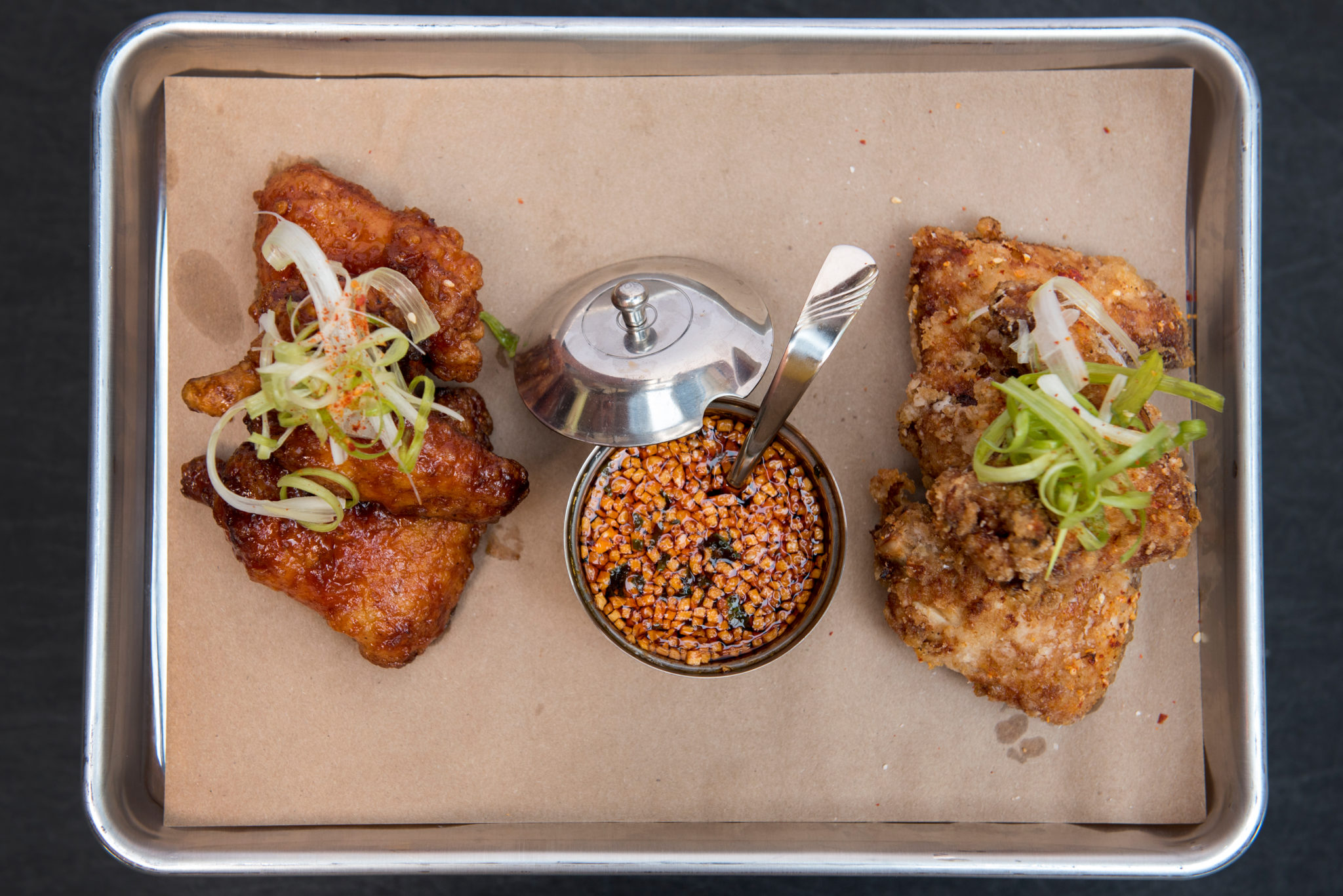 <p>CHIKO</p><p>The modern Chinese and Korean restaurant near Eastern Market overseen by chefs Danny Lee and Scott Drewno offers double-fried chicken wings ($9). Available either in spicy soy glazed or dry-spiced versions, they are great paired with an order of Sichuan spicy cucumbers ($3). (Image: CHIKO)</p>