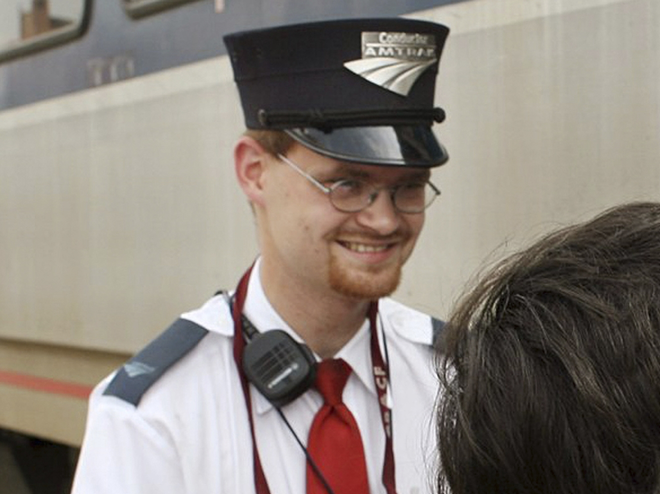 FILE - This Aug. 21, 2007 file photo shows Amtrak assistant conductor Brandon Bostian outside a train at the Amtrak station in St. Louis. Bostian was the engineer during the fatal May 12, 2015 Amtrak passenger train derailment in Philadelphia. The National Transportation Safety Board is scheduled to meet Tuesday, May 17, 2016, to detail the probable cause of last year's fatal derailment. (Huy Richard Mach/St. Louis Post-Dispatch via AP, File) EDWARDSVILLE INTELLIGENCER OUT; THE ALTON TELEGRAPH OUT; MANDATORY CREDIT