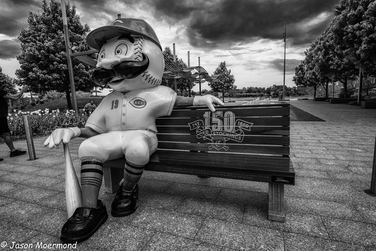 To celebrate the Reds' 150th Anniversary, 24 benches featuring Mr. Redlegs sculptures have been added to various spots around the area, as well as out of town locations including Dayton, Loveland, and Louisville, for the perfect Reds photo op. The mascot sports different uniforms from throughout the team's history at each of the benches. The Reds have been wearing these same throwback uniforms during their 2019 season.  / Location:{ }Smale Riverfront Park / Uniform: 2019 / Image courtesy of Instagram user @cincyshark79   // Published: 5.14.19
