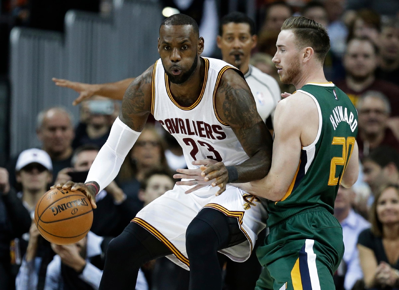 Cleveland Cavaliers' LeBron James (23) drives against Utah Jazz's Gordon Hayward (20) in the first half of an NBA basketball game, Thursday, March 16, 2017, in Cleveland. (AP Photo/Tony Dejak)
