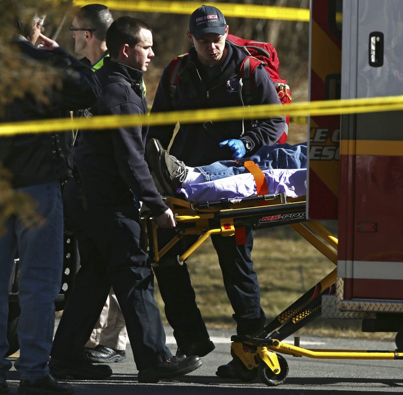 <p>Emergency personnel load an injured person into an ambulance near the scene of where an Amtrak train carrying multiple Republican lawmakers crashed into a garbage truck in Crozet, Va., on Wednesday, Jan. 31, 2018. A chartered train carrying dozens of GOP lawmakers to a Republican policy retreat in West Virginia struck a garbage truck in a rural Virginia town Wednesday. (Zack Wajsgras/The Daily Progress via AP)</p>