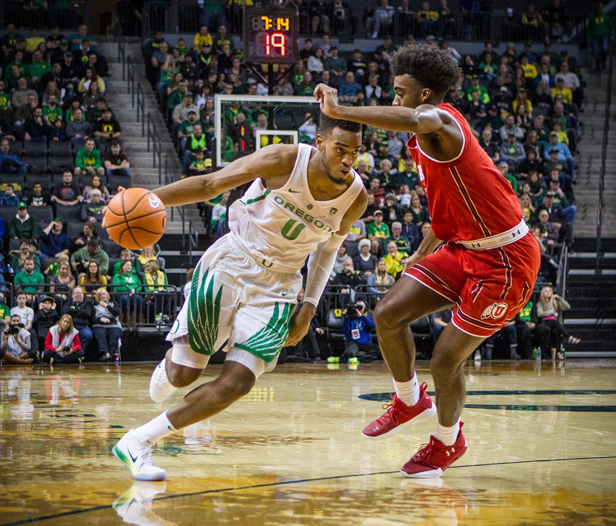 Oregon Ducks Troy Brown (#0) attempts to drive past Utah's defense. The Utah Utes defeated the Oregon Ducks 66-56 on Friday night at Matthew Knight Arena. This is the first Pac-12 conference game loss at home for the Ducks since January of 2015. This also ended the five home game winning streak for the Ducks against the Utah Utes. Photo by Rhianna Gelhart, Oregon News Lab