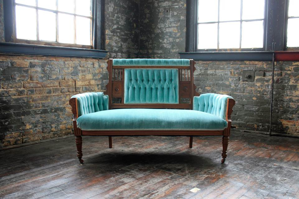 The famous Genevieve, the minty-turquoise-sea-glass sofa that started it all! -- Image courtesy of Queen City Vignette