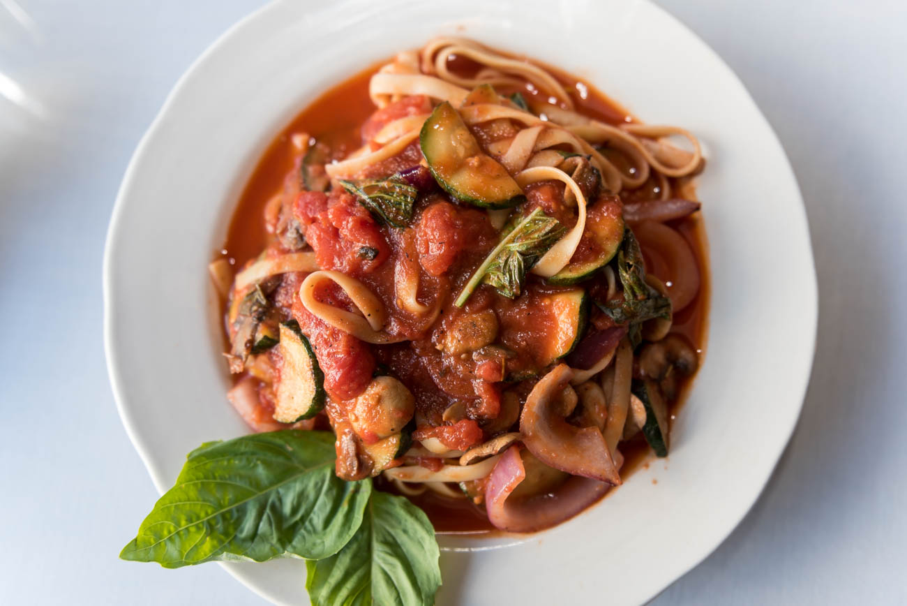 Pasta Primavera: zucchini, red onion, and mushrooms poached in a plum tomato sauce and tossed with fettuccine / Image: Mike Menke // Published: 6.20.18