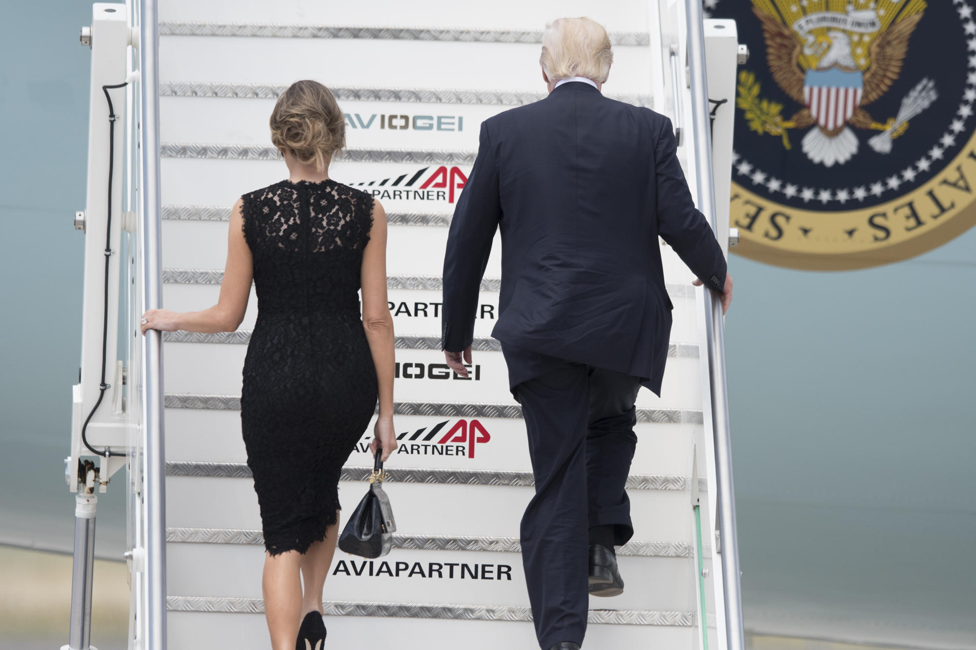 FLOTUS shed the D&G jacket leaving just the sleeveless lace dress (also Dolce &Gabbana) as she and her husband departed Italy. (Image: KIKA/WENN.com)