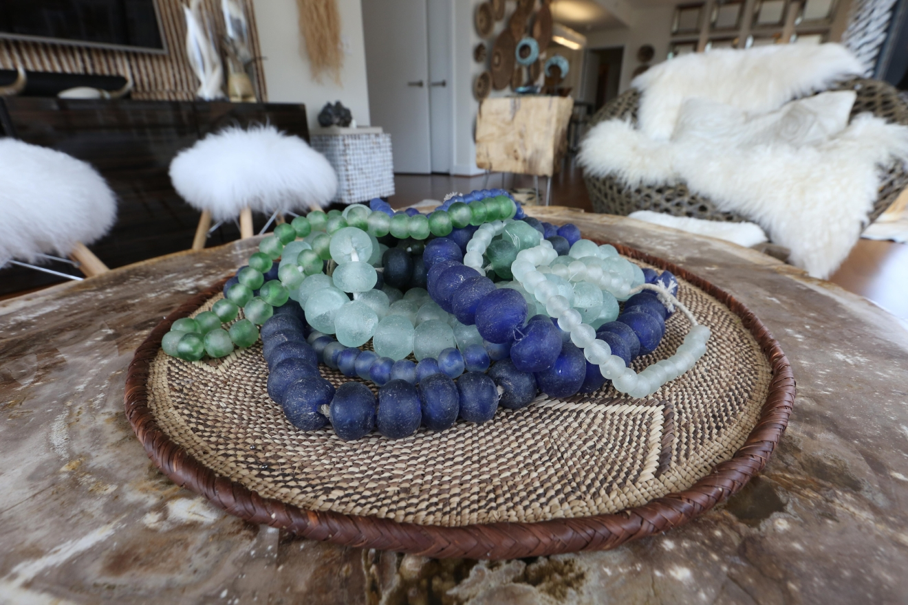 Natalie decorates her coffee table with antique African trade beads. (Amanda Andrade-Rhoades/DC Refined)