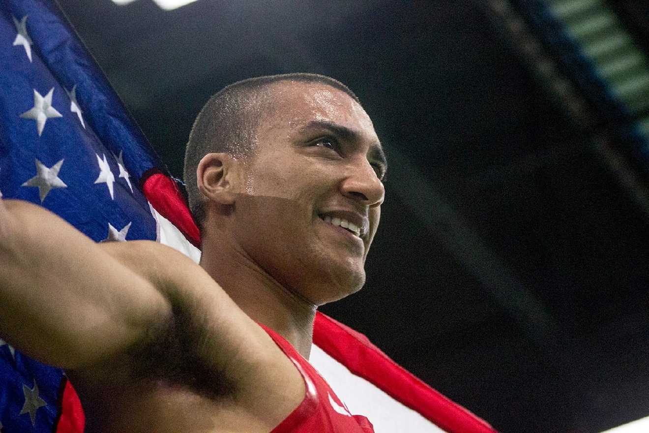 Ashton Eaton holds the American flag after finishing the men's 1000 meter race and earning the top score in the men's heptathlon. Eaton competed at the IAAF World Indoor Championships Saturday, March 19. Photo by Amanda Butt