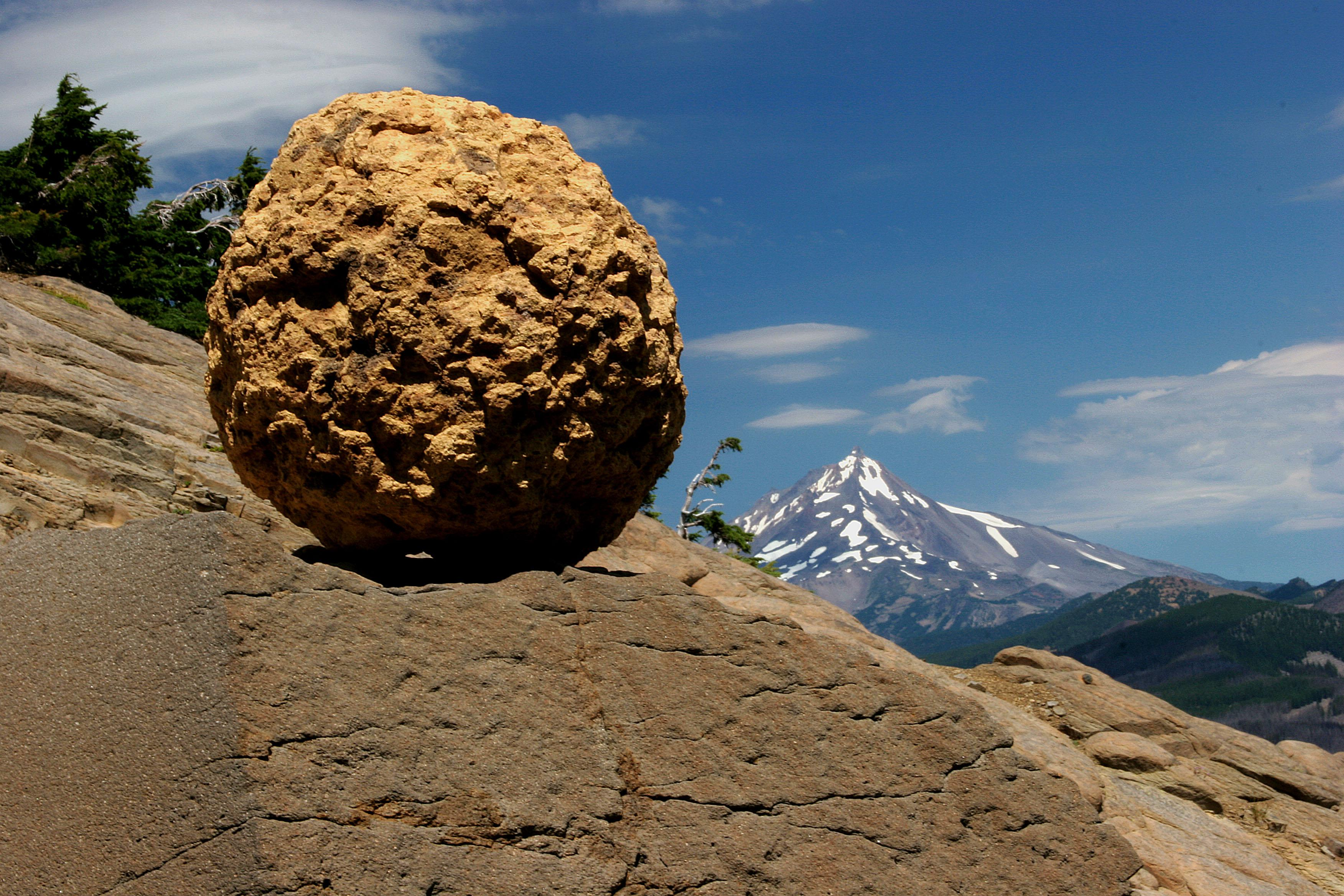 A stone sphere with Mount Jefferson in the distance (USDA Forest Service)