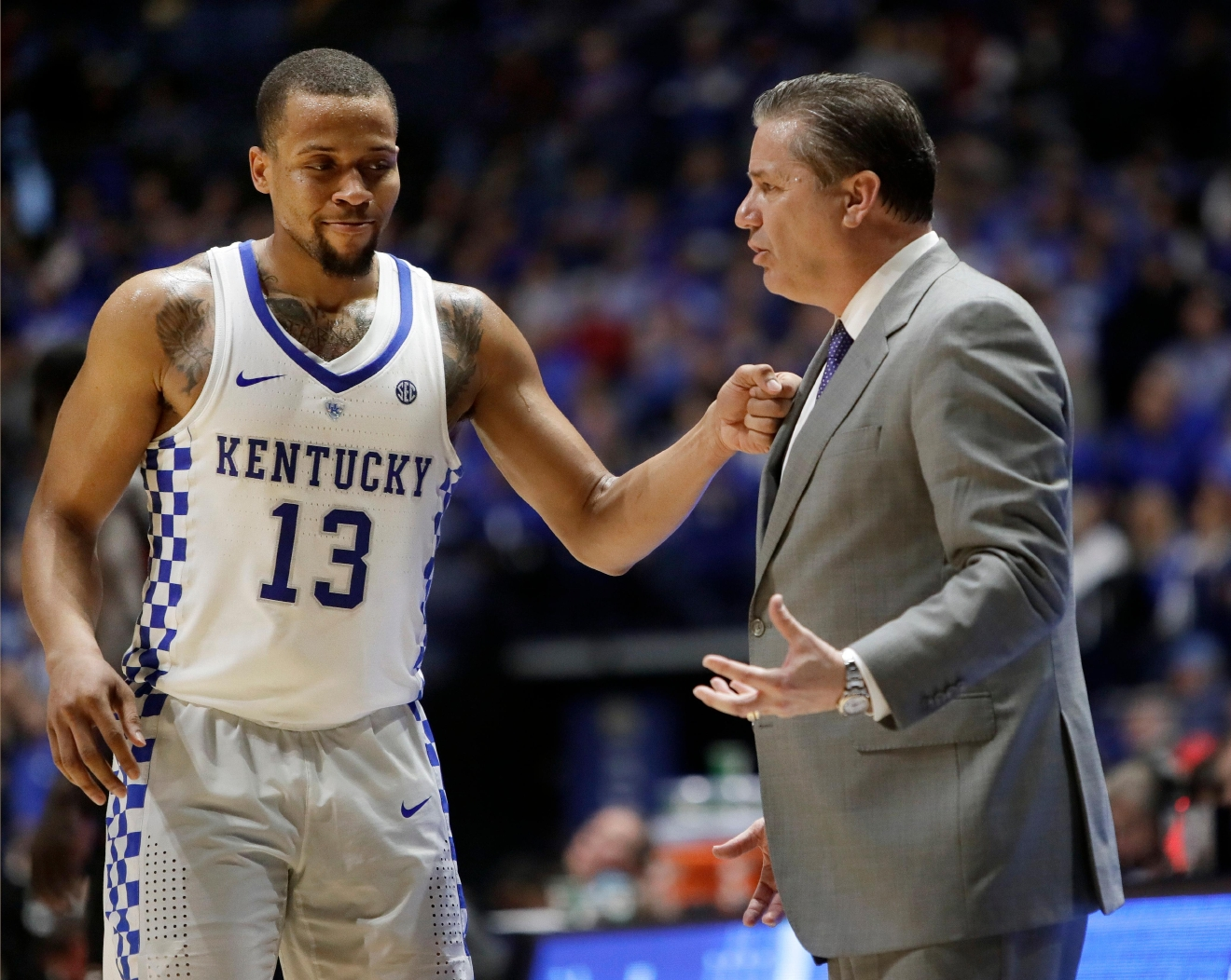 Kentucky guard Isaiah Briscoe (13) taps head coach John Calipari on the chest late in the second half of an NCAA college basketball game against Georgia at the Southeastern Conference tournament Friday, March 10, 2017, in Nashville, Tenn. Kentucky won 71-60. (AP Photo/Wade Payne)