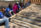 FOX 11's Emily Deem, left, helps lift a wall May 8, 2017, during a National Women Build Week Habitat for Humanity event in Green Bay.