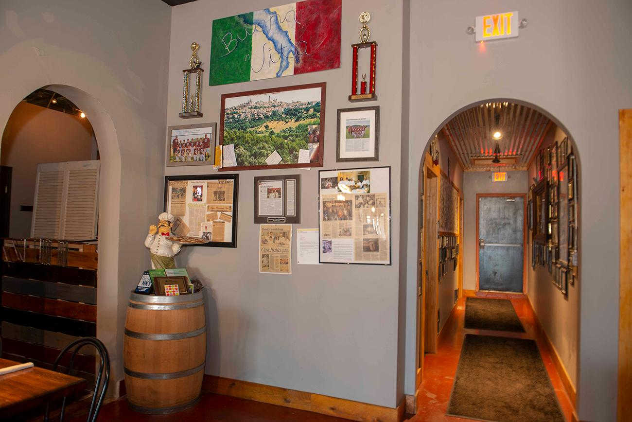 <p>The walls in the restaurant pay tribute to the owner's ancestors, the Bonavita and Vilardo families, who came from a small town in Italy called Fuscaldo. They influenced the heritage and flavors that Chef Frommeyer still incorporates into the restaurant. / Image: Joe Simon //Published: 3.10.19</p><p></p>