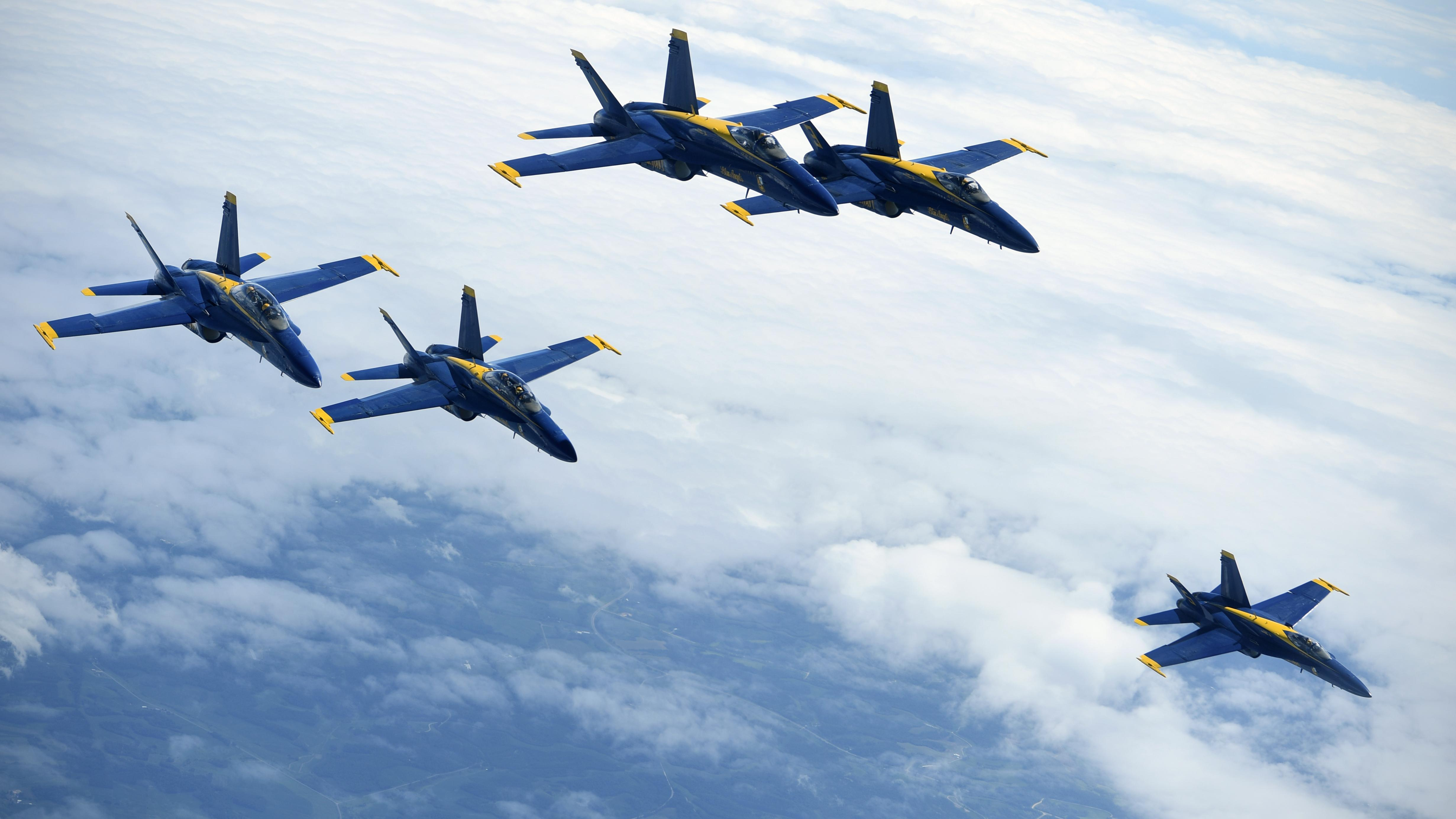 Five of the U.S. Navy F/A-18 Hornet Blue Angels from Pensacola Naval Air Station, Florida, fly beside a 434th Air Refueling Wing KC-135R Stratotanker over the Midwest July 25, 2018. Grissom represented the Hoosier Wing's air refueling capabilities and participated in the annual AirVenture air show with the Blue Angels at Wittman Regional Airport in Oshkosh. (U.S. Air Force photo by Staff Sgt. Katrina Heikkinen)