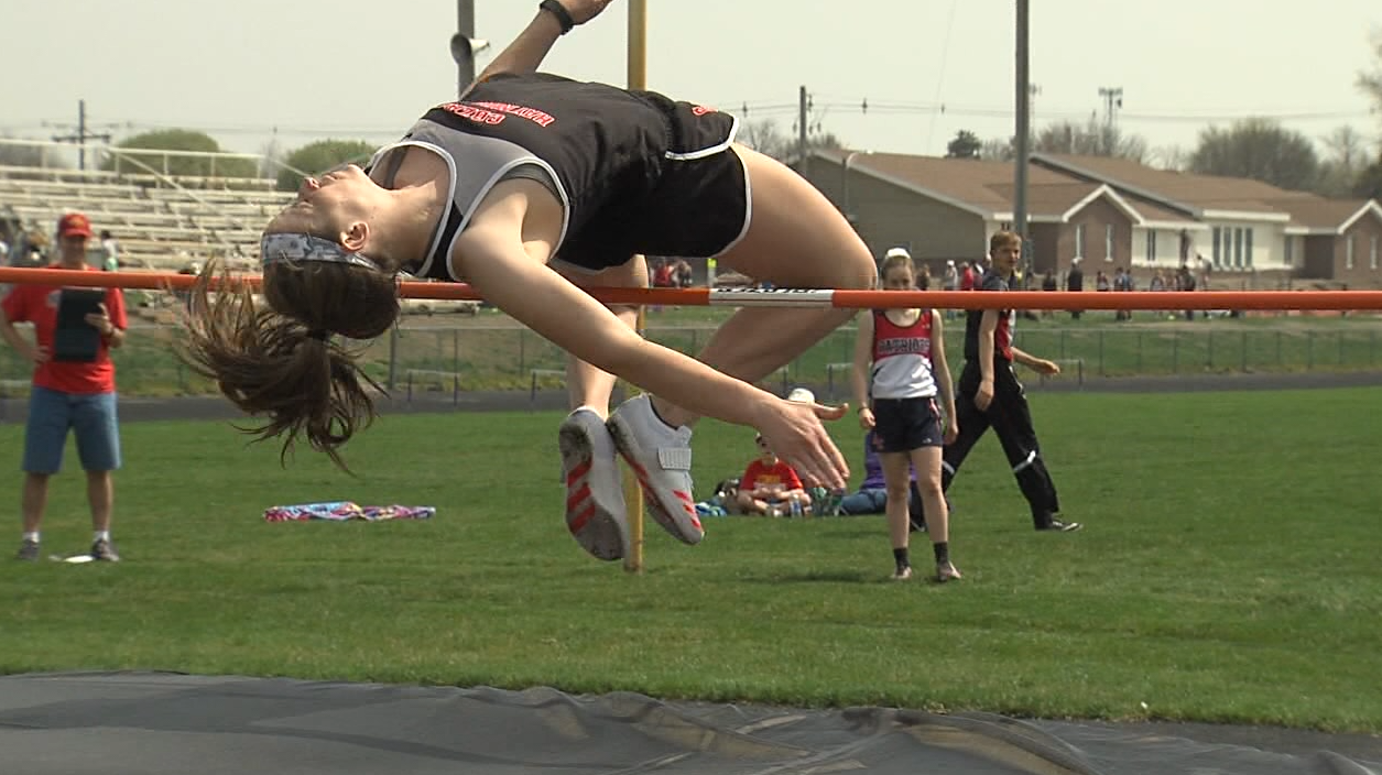 Kennedy Berreckman of Cozad clears the high jump of 4 feet 10 inches at the Marsh Beck Invite in Minden, April 13, 2017.  She went on to win with a jump of 5 feet (NTV News)