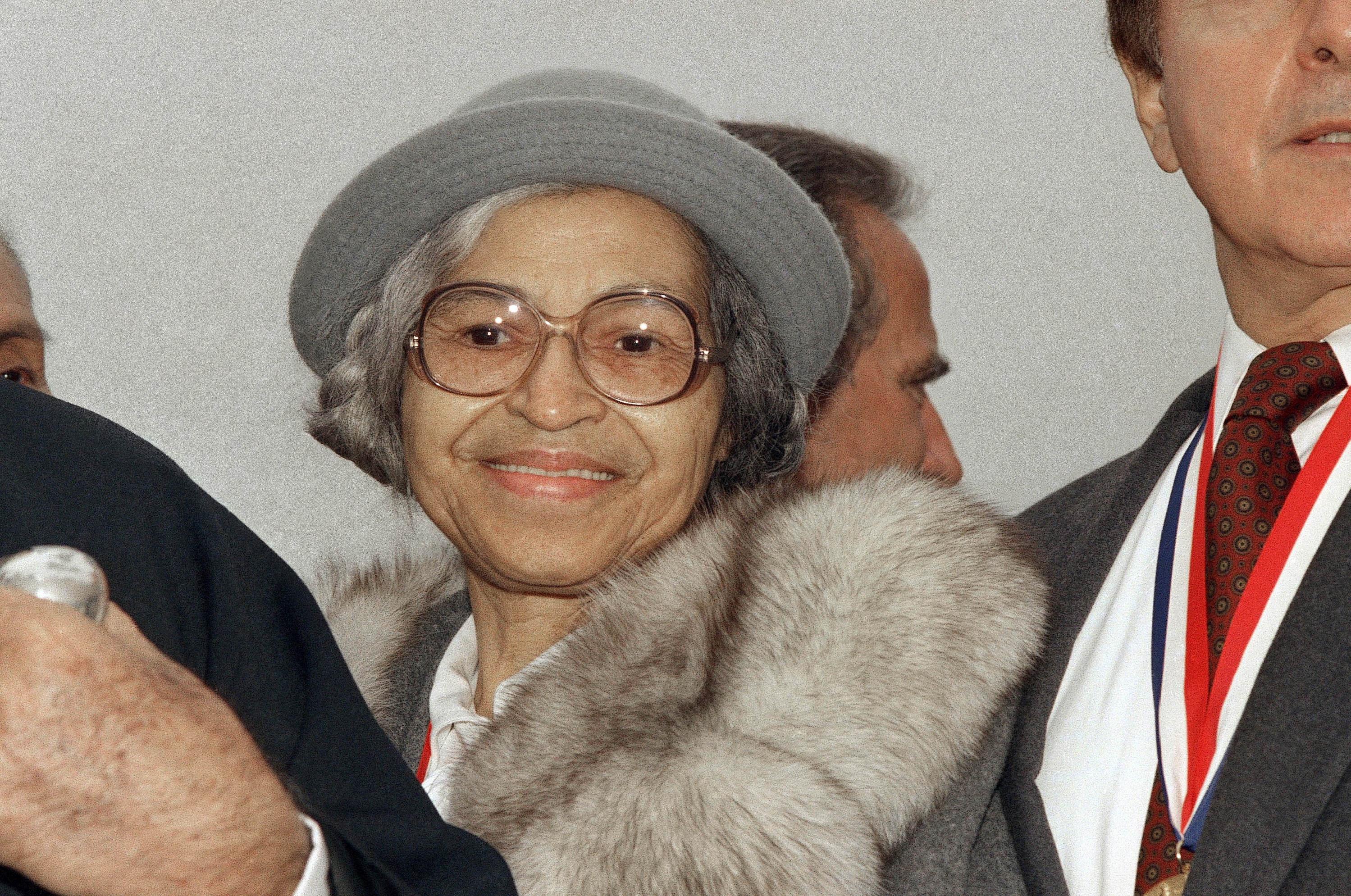 FILE - This Oct. 28, 1986, file photo shows Rosa Parks at Ellis Island in New York. The AP reported on Aug. 25, 2017, that a story circulating online that Parks' daughter praised President Donald Trump's response to violence in Charlottesville, Va. is false. Parks didn't have any children. (AP Photo, File)